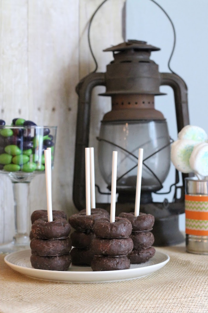 Mini chocolate donuts stacked on lollipop sticks from a Vintage Classic Train Themed Birthday Party on Kara's Party Ideas | KarasPartyIdeas.com (17)