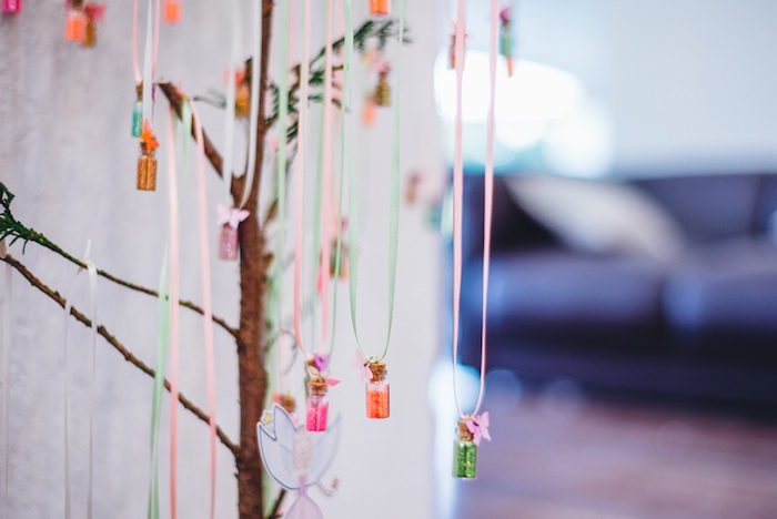 Pixie dust capsules hung from a tree at a Whimsical Fairies & Butterflies Birthday Party via Kara's Party Ideas KarasPartyIdeas.com (25)