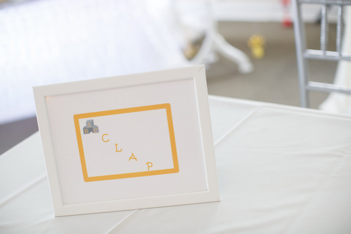 """A Baby's first"" party sign from a Yellow & Gray Alphabet Baby Shower + Gender Reveal via Kara's Party Ideas 