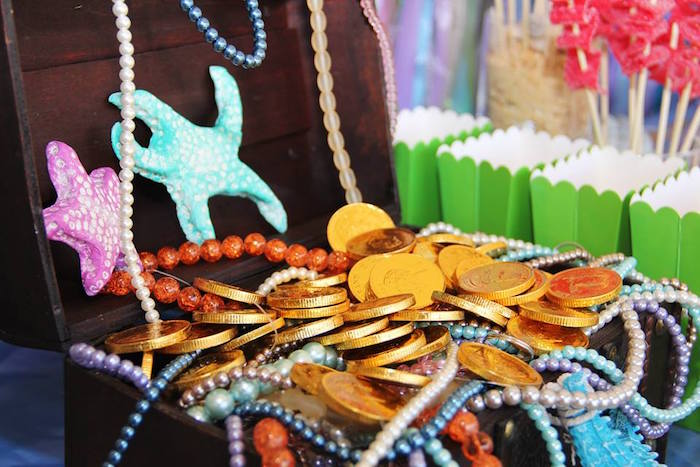 Treasure chest filled with beads and chocolate gold coins from an Ariel + The Little mermaid Birthday Party on Kara's Party Ideas | KarasPartyIdeas.com (12)