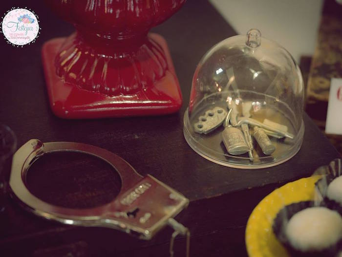 Handcuffs/decor from a Detective + Mystery Birthday Party on Kara's Party Ideas | KarasPartyIdeas.com (8)