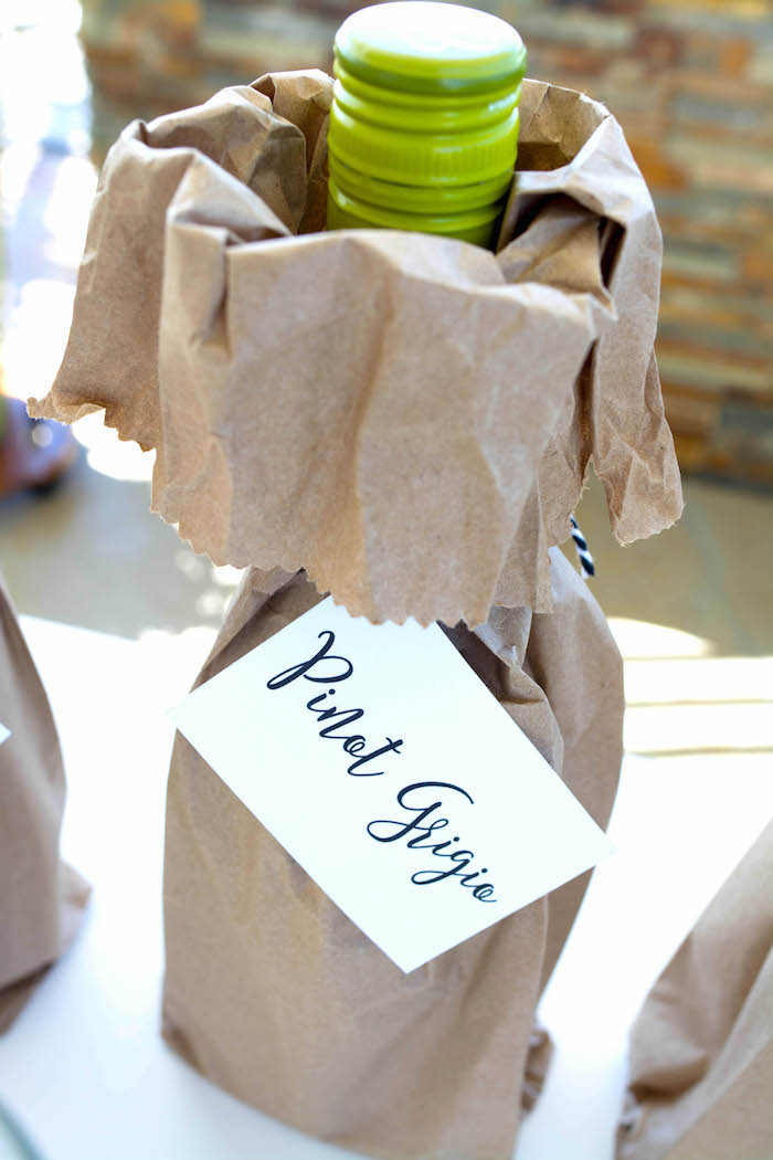 Drink bottle placed in brown paper bag with custom name label from an End of Summer Pineapple Themed Girls Night Party on Kara's Party Ideas | KarasPartyIdeas.com (20)
