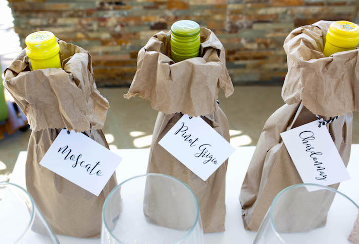 Drink bottles placed in brown paper bags with custom name labels from an End of Summer Pineapple Themed Girls Night Party on Kara's Party Ideas | KarasPartyIdeas.com (17)