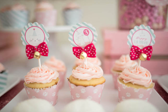 Cupcakes adorned with bows and bells from a Kitty Cat Birthday Party on Kara's Party Ideas | KarasPartyIdeas.com (23)