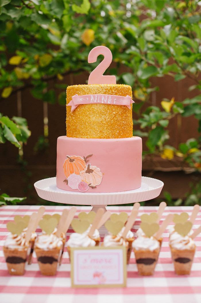"Adorable pink and gold birthday cake from a ""Little Pumpkin"" Fall Picnic Birthday Party on Kara's Party Ideas 