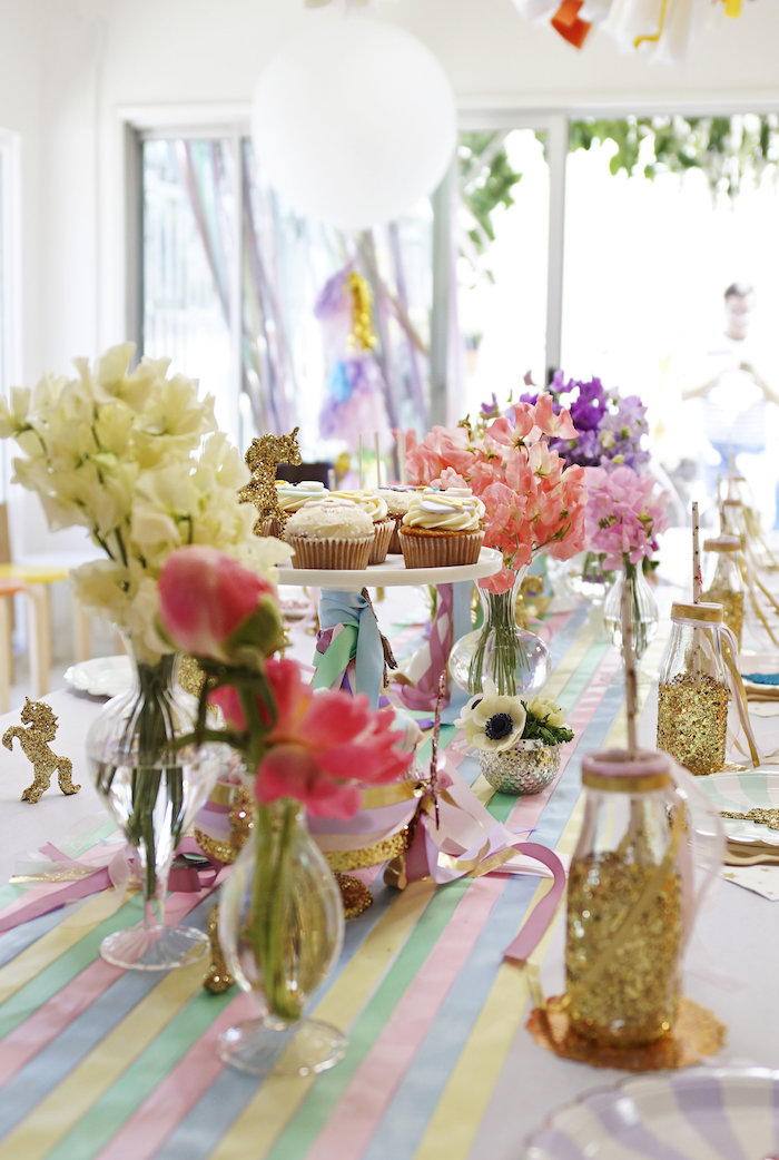 "Guest table centerpieces + party details form a Magical ""Magic is Four Real"" Unicorn Birthday Party on Kara's Party Ideas 