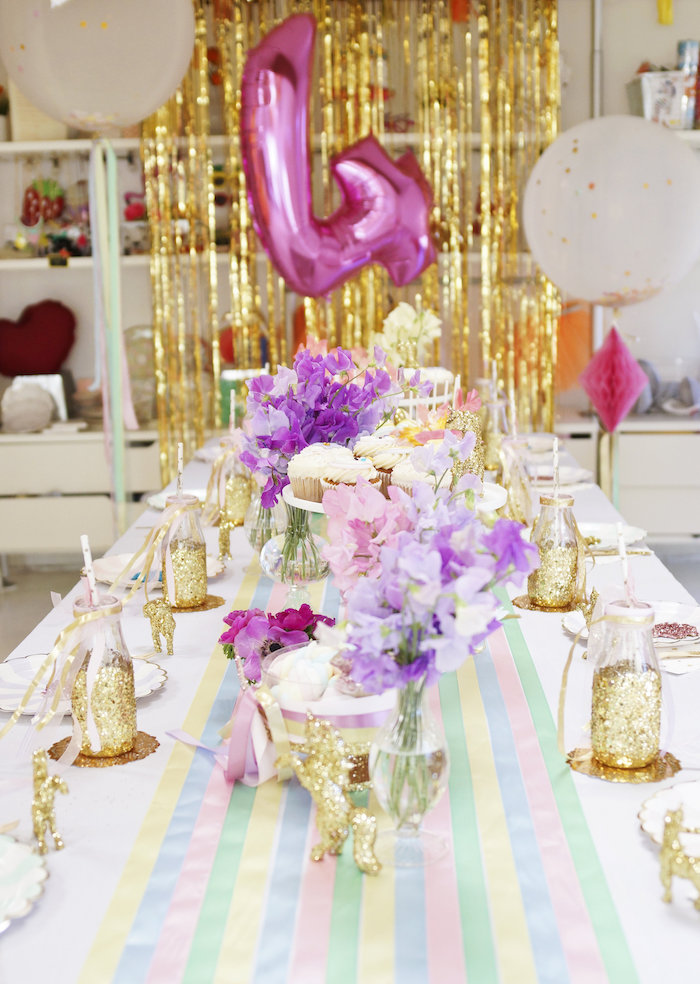 "Guest table from a Magical ""Magic is Four Real"" Unicorn Birthday Party on Kara's Party Ideas 
