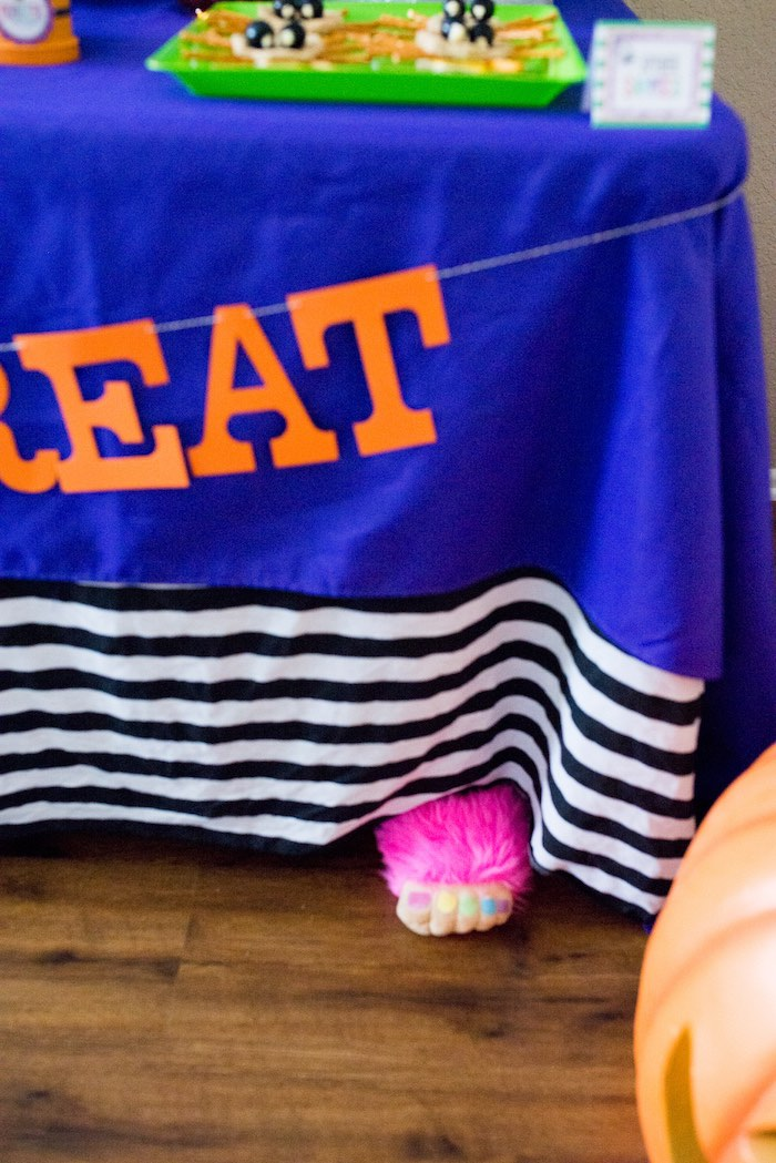 Monster hand sticking out from under the table from a Monster Mash Halloween Party on Kara's Party Ideas   KarasPartyIdeas.com (52)