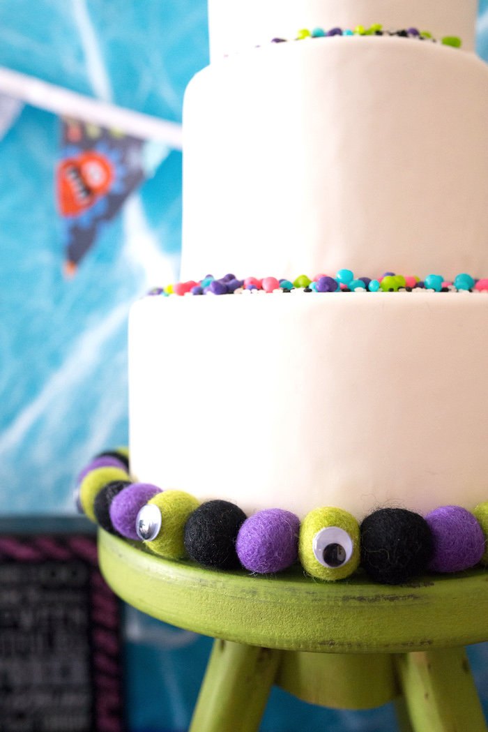 Felt balls outlining the base of a cake from a Monster Mash Halloween Party on Kara's Party Ideas   KarasPartyIdeas.com (29)