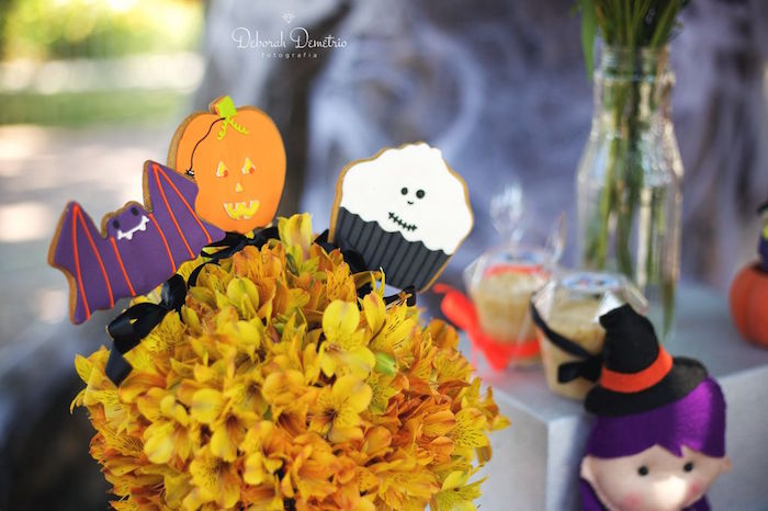 Halloween cookies in flowers from an Orange + Purple & Black Halloween Party on Kara's Party Ideas | KarasPartyIdeas.com (36)