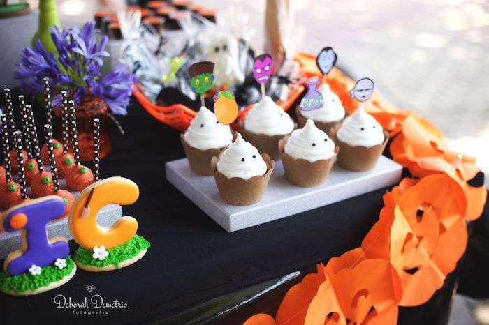 Ghost cupcakes from an Orange + Purple & Black Halloween Party on Kara's Party Ideas | KarasPartyIdeas.com (12)