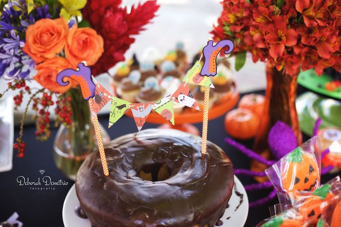 Chocolate bundt cake with witch feet banner from an Orange + Purple & Black Halloween Party on Kara's Party Ideas | KarasPartyIdeas.com (5)