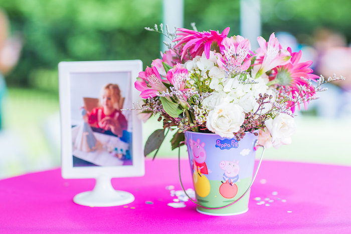 Peppa pig bucket filled with colorful flowers from a Peppa Pig Birthday Party on Kara's Party Ideas | KarasPartyIdeas.com (26)