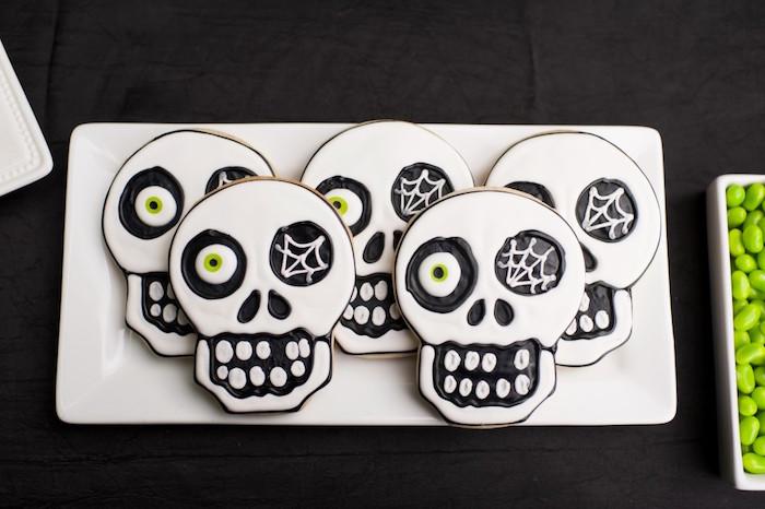 Skull sugar cookies from a Spooktacular Halloween Party via Kara's Party Ideas | KarasPartyIdeas.com (32)