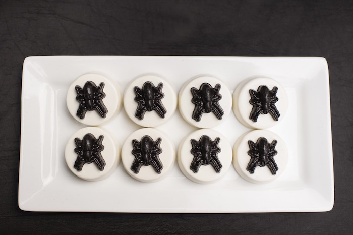 Chocolate covered Halloween Oreos with black spider toppers from a Spooktacular Halloween Party via Kara's Party Ideas | KarasPartyIdeas.com (29)