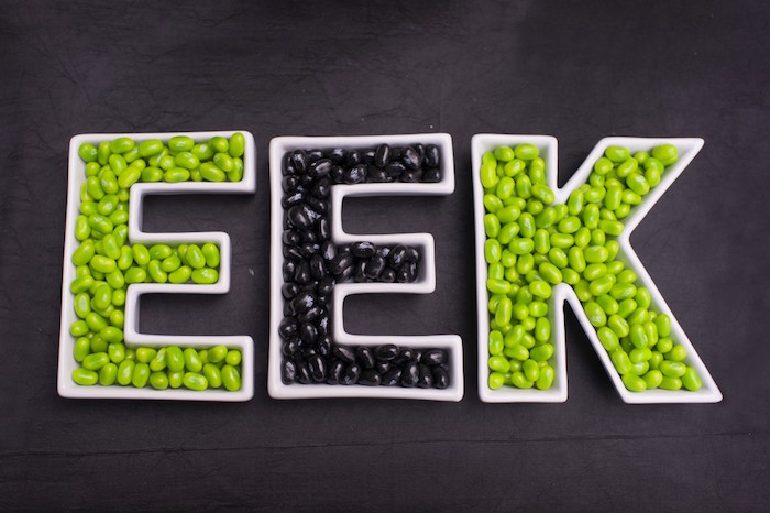 """Ceramic """"EEK"""" letter dishes filled with black and green jelly beans from a Spooktacular Halloween Party via Kara's Party Ideas 