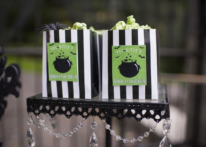green popcorn in black white striped favor bags from a spooktacular halloween party via karas - Black And White Halloween Party