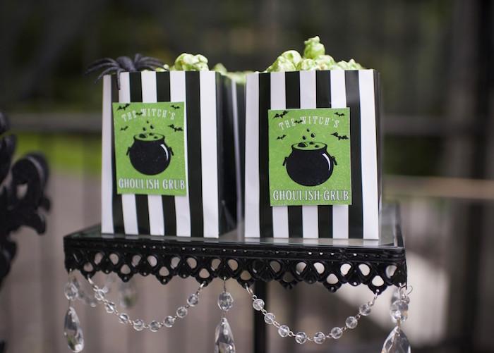 Green popcorn in black + white striped favor bags from a Spooktacular Halloween Party via Kara's Party Ideas | KarasPartyIdeas.com (19)