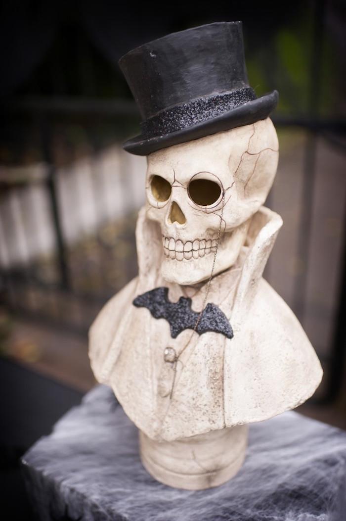 Skeleton bust head wearing a top hat from a Spooktacular Halloween Party via Kara's Party Ideas | KarasPartyIdeas.com (16)