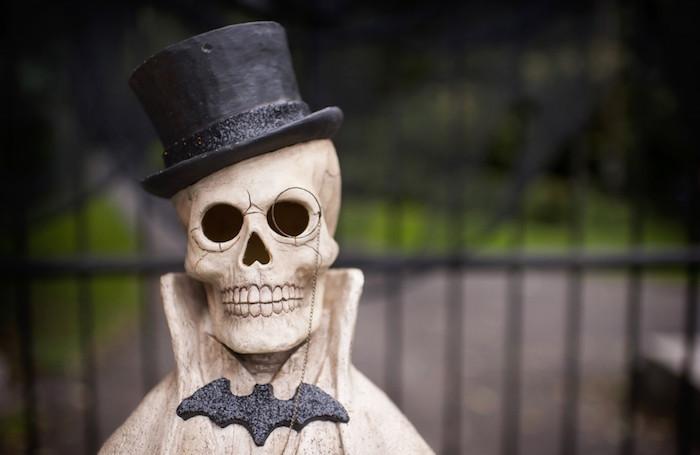 Skeleton bust head wearing a top hat from a Spooktacular Halloween Party via Kara's Party Ideas | KarasPartyIdeas.com (15)