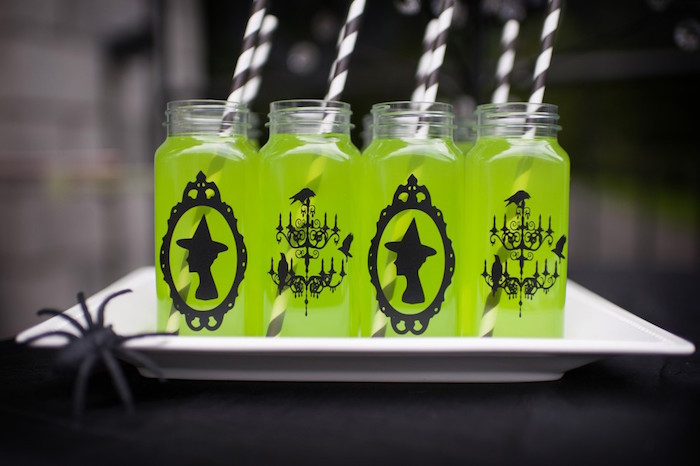 green potion beverages served in french square milk bottles from a spooktacular halloween party via karas - Haloween Party Ideas