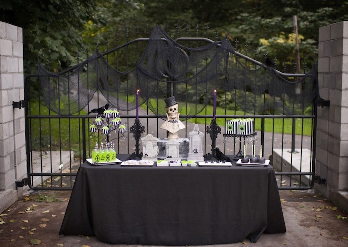 Dessert Table With Iron Gate Backdrop From A Spooktacular Halloween Party Via Karas Ideas