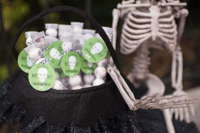 Gumball favor tubes with skeleton gumballs and tags from a Spooktacular Halloween Party via Kara's Party Ideas | KarasPartyIdeas.com (35)
