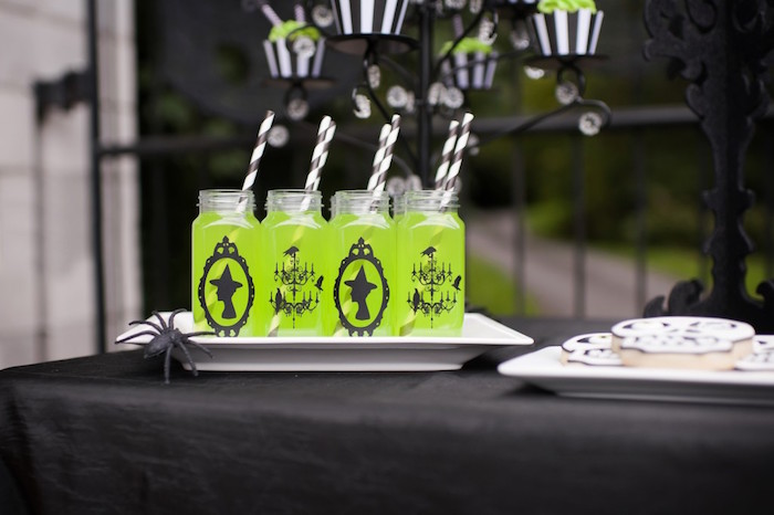 Green potion beverages served in square plastic milk bottles from a Spooktacular Halloween Party via Kara's Party Ideas | KarasPartyIdeas.com (34)
