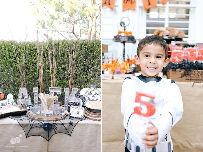 Party table & birthday boy from a Spooky Halloween Inspired Birthday Party on Kara's Party Ideas | KarasPartyIdeas.com (9)
