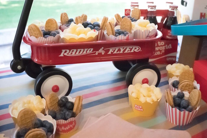 Radio Flyer wagon filled with sweets and treats from a Vintage Little Golden Trains Birthday Party on Kara's Party Ideas | KarasPartyIdeas.com (32)