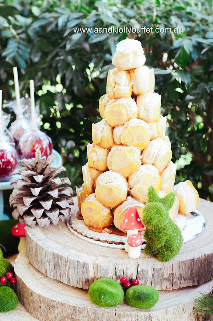 eclair tower from a woodland forest baby shower via kara 39 s party ideas