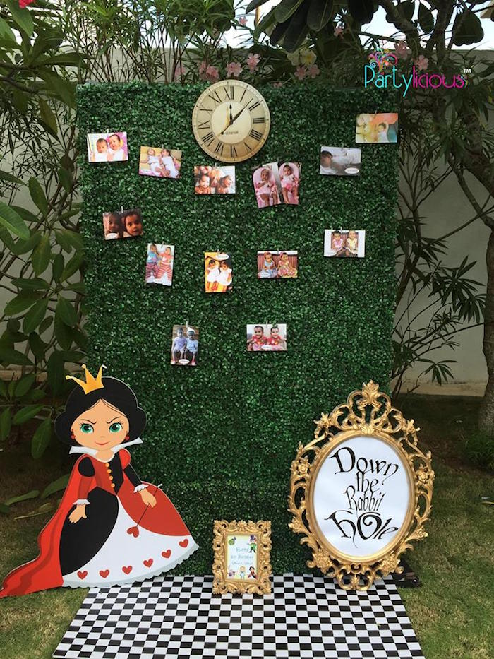 Alice in Wonderland photo wall from an Alice in Wonderland Birthday Tea Party on Kara's Party Ideas | KarasPartyIdeas.com (21)