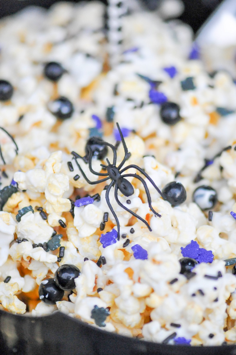 Purple, black white popcorn. Boneyard Skull Halloween Party tablescape and dessert table by Kara Allen | Kara's Party Ideas for Party City