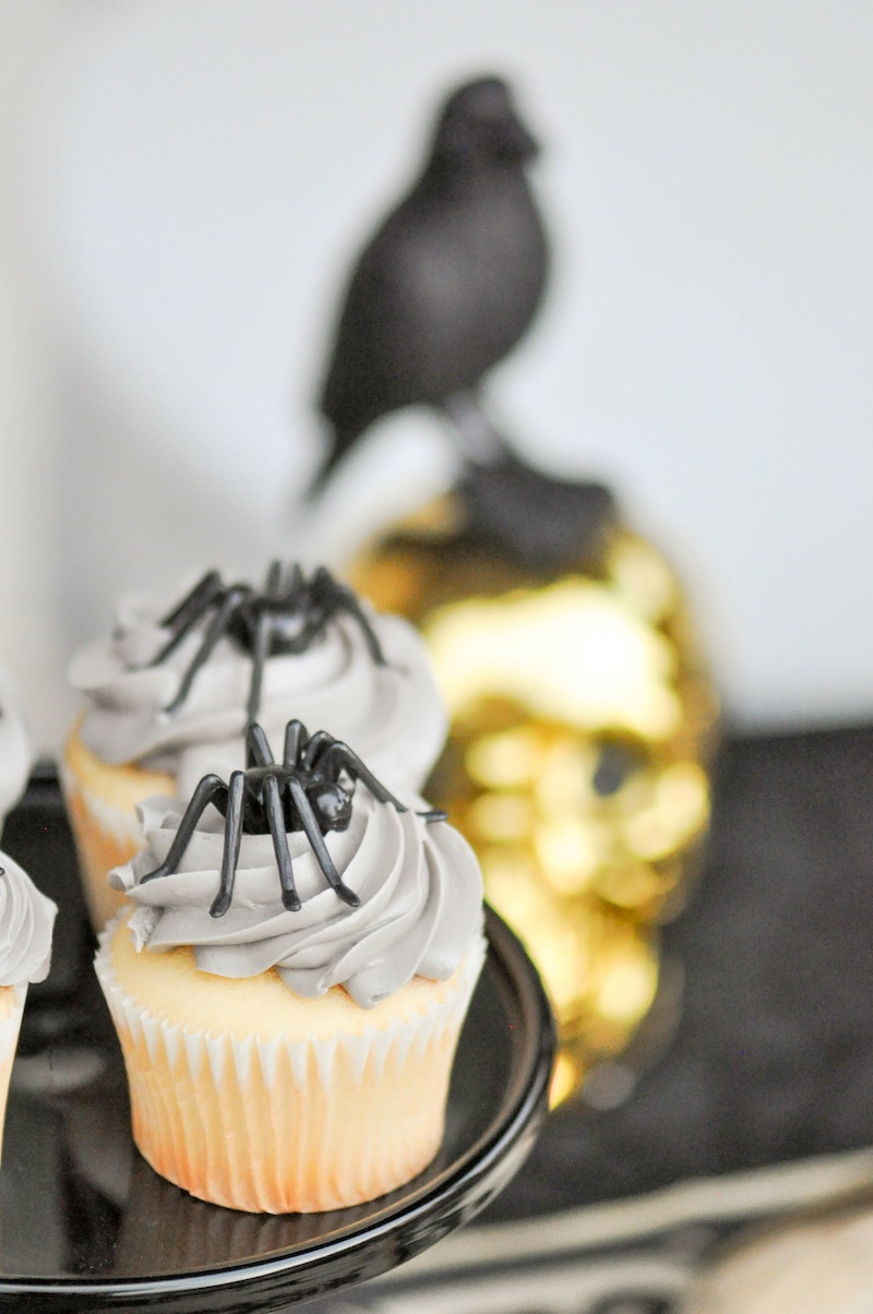Grey spider cupcakes. Boneyard Skull Halloween Party tablescape and dessert table by Kara Allen | Kara's Party Ideas for Party City