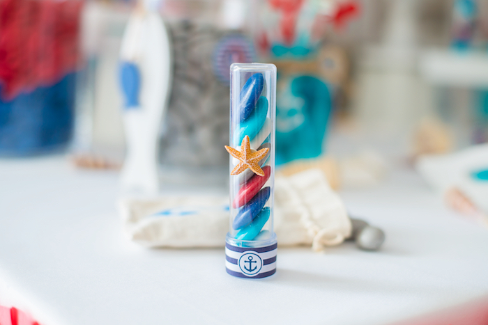 Sea shell-inspired favor tube from a Little Sailor Nautical Baby Shower on Kara's Party Ideas | KarasPartyIdeas.com (5)