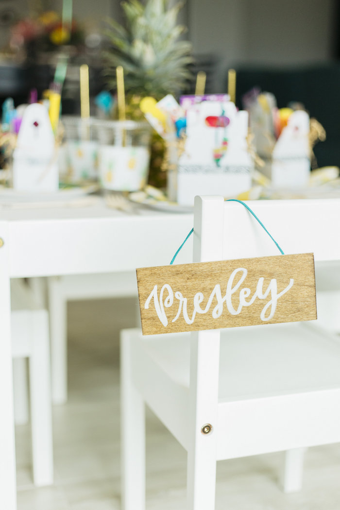 "Wooden name seating assignment sign from a Modern Tropical ""Cheers to Sixty"" Birthday Party on Kara's Party Ideas 