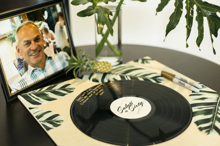 "Vinyl record for guest signatures from a Modern Tropical ""Cheers to Sixty"" Birthday Party on Kara's Party Ideas 