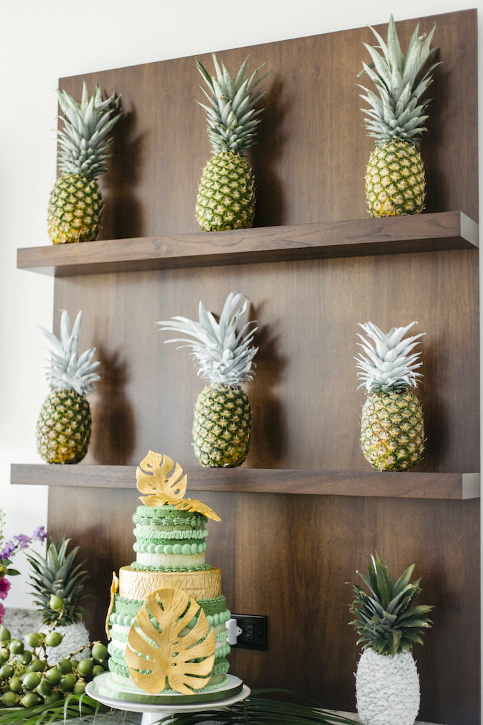 "Painted pineapples from a Modern Tropical ""Cheers to Sixty"" Birthday Party on Kara's Party Ideas 
