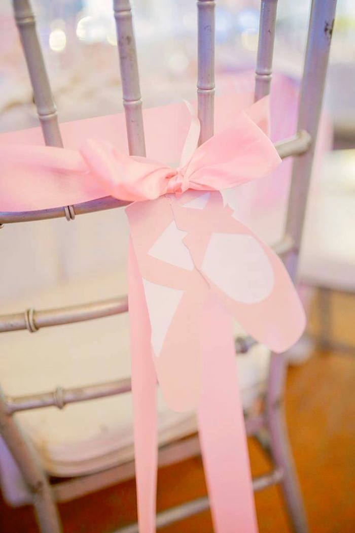 Chair backs tied with paper ballet slippers from a Nutcracker Ballerina Birthday Party on Kara's Party Ideas | KarasPartyIdeas.com (26)