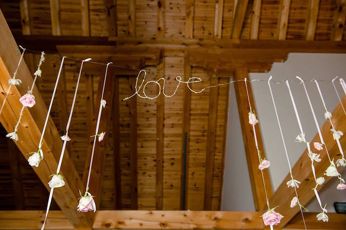 "Rose ""love"" garland from a Rustic Chic Mountain Wedding on Kara's Party Ideas 