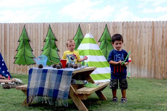 Picnic table from a Rustic Woodland Camping Birthday Party on Kara's Party Ideas | KarasPartyIdeas.com (17)