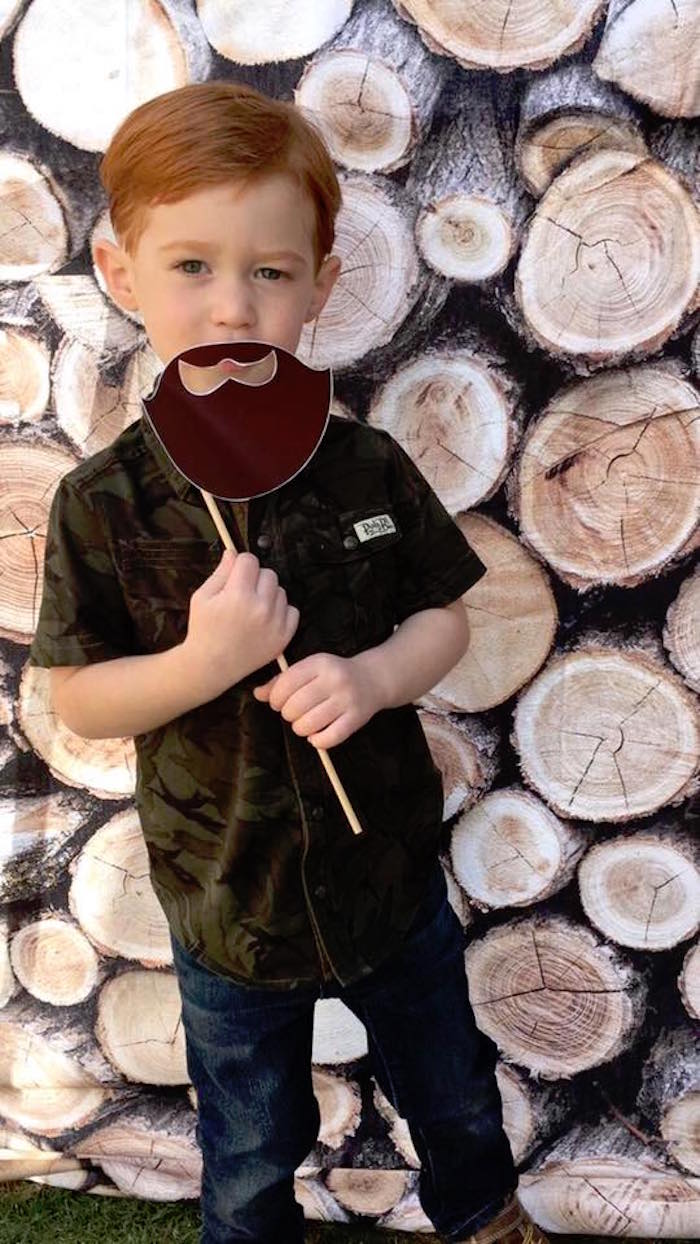 Wood pile photo booth from a Rustic Woodland Camping Birthday Party on Kara's Party Ideas | KarasPartyIdeas.com (10)