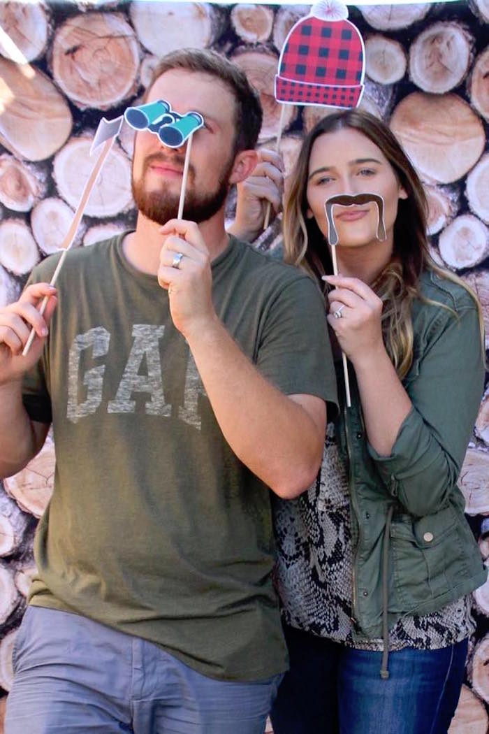 Wood pile photo booth from a Rustic Woodland Camping Birthday Party on Kara's Party Ideas | KarasPartyIdeas.com (7)