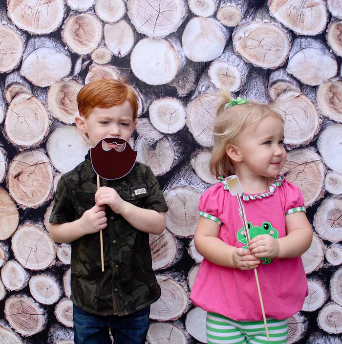 Wood pile photo booth from a Rustic Woodland Camping Birthday Party on Kara's Party Ideas | KarasPartyIdeas.com (21)