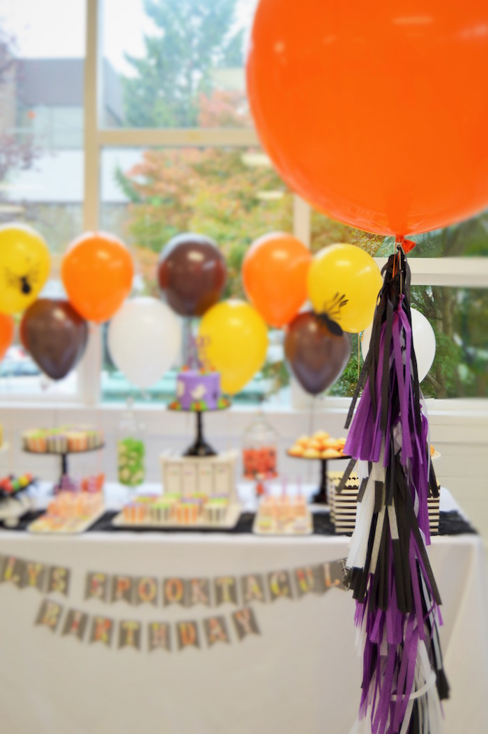 Oversized orange balloon with purple & black tassel tail from a Spooktacular Halloween Birthday Party on Kara's Party Ideas | KarasPartyIdeas.com (12)