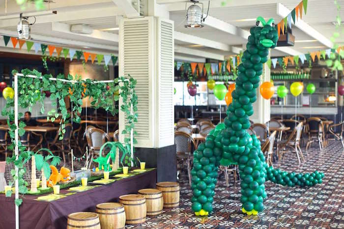 Balloon dinosaur & guest table from a Good Dinosaur Birthday Party on Kara's Party Ideas | KarasPartyIdeas.com (7)
