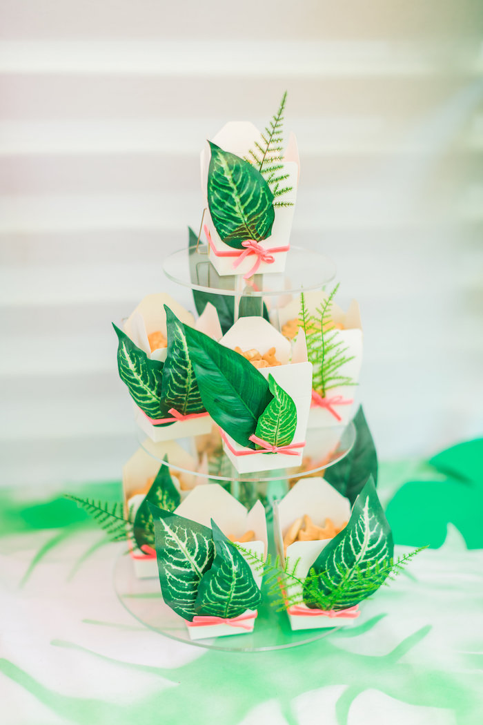 Tropical leaves adorning animal cracker-filled favor boxes from a Tropical FOURest Birthday Party on Kara's Party Ideas | KarasPartyIdeas.com (31)