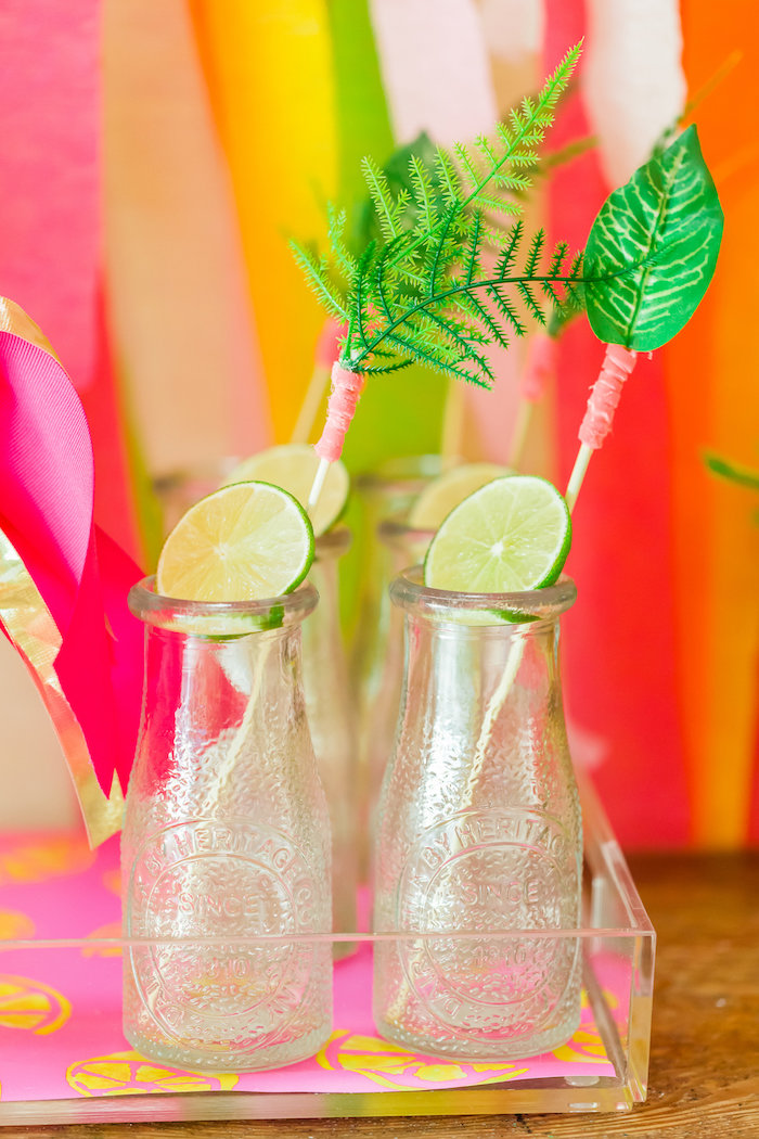 Glass milk bottle with limes and ferns from a Tropical FOURest Birthday Party on Kara's Party Ideas | KarasPartyIdeas.com (21)