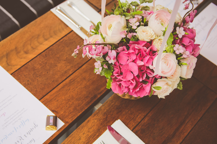 Guest tabletop with a pink floral arrangement from an Urban Gender Reveal Party on Kara's Party Ideas | KarasPartyIdeas.com (10)
