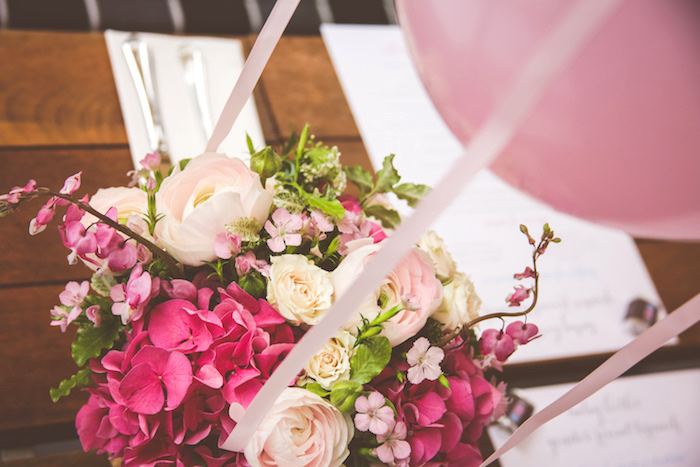 Pink flower centerpiece from an Urban Gender Reveal Party on Kara's Party Ideas | KarasPartyIdeas.com (9)
